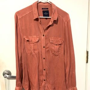 salmon colored long sleeve collared shirt